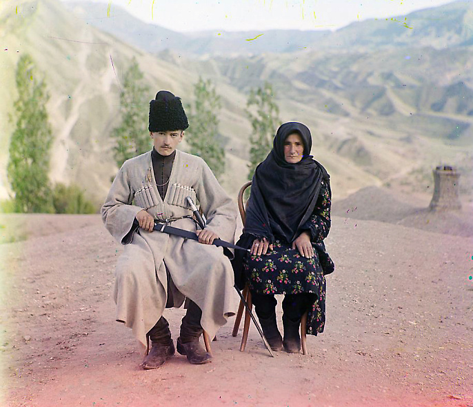 Dagestani types, Man and woman posed outdoors; between 1905 and 1915
